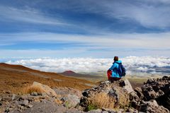 Tourist admiring breathtaking view of Mauna Loa volcano on the Big Island of Hawaii. The largest subaerial volcano in both mass and volume, Mauna Loa has been Stock Photo