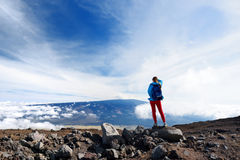 Tourist admiring breathtaking view of Mauna Loa volcano on the Big Island of Hawaii, USA Stock Photography
