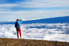Tourist admiring breathtaking views from the Mauna Kea, a dormant volcano on the island of Hawaii Royalty Free Stock Images