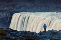Tourist admiring view of falling water of the most powerful wate Royalty Free Stock Photography