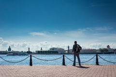 Tourist admiring views of the Neva River Stock Image