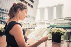 Tourist adventure with map. In singapore Royalty Free Stock Photos