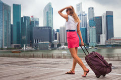 Tourist adventure. With suitcase in Singapore Royalty Free Stock Photography