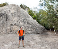 The tourist against pyramid ruins Mexico. Archeologic zone Kabah. Stock Images