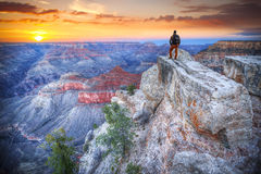 Tourist in America. Man in the Grand Canyon at sunrise. tourist in America Stock Images
