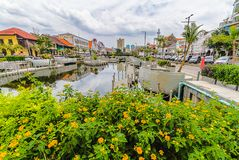 Little yellowish flower with old buildings, reflection on the water, and cloudy sky background, Old City Tourism Area. stock photography