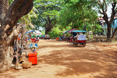 Tourist arriving by tuk-tuk in village near Royalty Free Stock Image