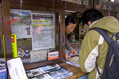 Tourist asking directions. A tourist asking directions at the information office of Takayama, Gifu, Japan Royalty Free Stock Photo