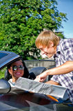 Tourist asking driver about direction. Male tourist asking female driver about direction Royalty Free Stock Photography