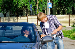 Tourist asking female driver about direction. Male tourist asking female driver about direction Stock Images