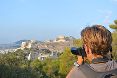Tourist in Athen. Woman with camcorder takes a picture at Acropolis in Athen (Greece Royalty Free Stock Photo