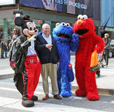 Tourist Attraction. Mickey Mouse, Cookie Monster and Elmo posing with tourist for a photo in Times Square,NY Stock Images