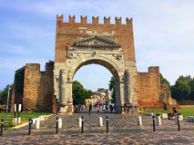 Arch of Augustus - Roman gate and historical landmark of Rimini, Italy. Tourist attraction - Arch of Augustus. Roman gate and historical landmark of Rimini Royalty Free Stock Images