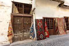 Tourist attraction. Street in old city with carpet shops. royalty free stock photo