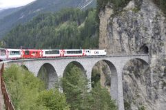 Tourist attraction: Crossing the swiss alps in the Glacier Express train. DIe Touristenattraktion: Alpentransversale im Glacier E. Crossing the swiss alps in the royalty free stock photo