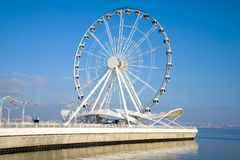 Tourist attraction - a ferris wheel on the shore of the Caspian Sea. Baku. Tourist attraction - a ferris wheel on the shore of the Caspian Sea on a sunny stock photos