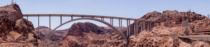 Desert panorama in Arizona-Nevada and the construction of the Hoover Dam hydroelectric plant. Tourist attraction of Nevada and Arizona, USA. The Hoover Dam and royalty free stock photo