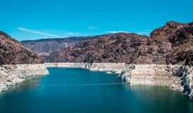 Lake Mead. Reservoir on the Colorado River, Hoover Dam. Tourist attraction of Nevada and Arizona, USA. The Hoover Dam and the arch bridge over the Colorado River Royalty Free Stock Photo