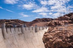 Powerful hydroelectric power station on the Colorado River in Nevada. Hoover Dam. Tourist attraction of Nevada and Arizona, USA. The Hoover Dam and the arch Royalty Free Stock Photography