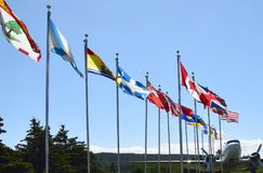Harbour Grace aviation history site, NL Canada. Tourist attraction site at Harbour Grace showing the towns aviation history, provincial flags of Canada line up royalty free stock photo