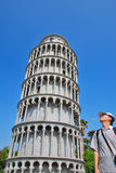 Tourist awed at ancient architecture Stock Photos