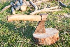 Tourist ax stuck in stump Stock Photos