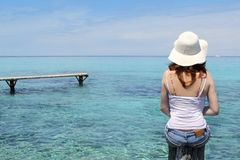Tourist back woman in Formentera turquoise sea Stock Photos