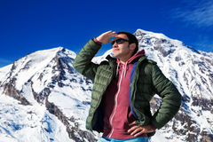 Tourist on the background of snowy mountains. Man with a map looking forward to the background of snowy mountains. Grossglockner, Austria Stock Images