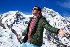 Tourist on the background of snowy mountains. Man with a map looking forward to the background of snowy mountains. Grossglockner, Austria Stock Photo
