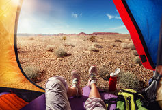 Tourist background. Tourist tent camping in desertn Stock Photos