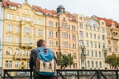 A tourist with a backpack on the backdrop of the old architecture in Prague in the Czech Republic. Travel, tourism. A tourist with a backpack on the backdrop of Royalty Free Stock Photography