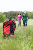 Tourist backpack and couple on country walk Royalty Free Stock Image