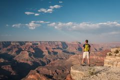 Tourist with backpack at Grand Canyon. Arizona, USA Royalty Free Stock Images