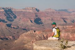 Tourist with backpack at Grand Canyon Royalty Free Stock Photos