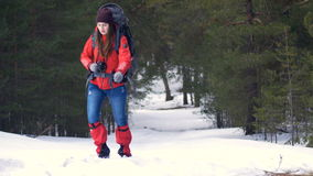 Tourist with backpack hiking in winter mountain forest. Hiking, Climbing, Trekking concept. stock video