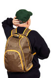 Tourist with a backpack. Male tourist with a backpack and a baseball cap looking upwards with his head, white background Royalty Free Stock Photo
