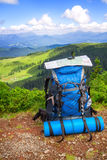 Tourist backpack with map on mountains background Stock Images