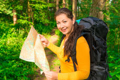 Tourist with backpack and map. Smiling Royalty Free Stock Image