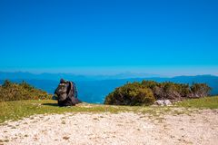 Tourist backpack in mountain landscape Stock Image