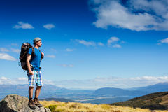 Tourist with a backpack and mountain panorama Stock Image