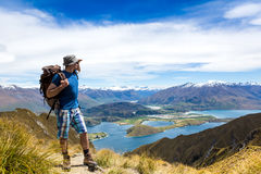 Tourist with a backpack and mountain panorama Stock Images