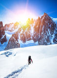 Tourist with a backpack and mountain panorama. Royalty Free Stock Photography