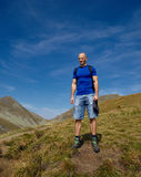 Tourist with backpack on mountain trail Royalty Free Stock Photography