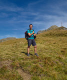 Tourist with backpack on mountain trail Stock Photography
