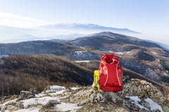 Tourist backpack in mountains landscape under blue sky Stock Photography