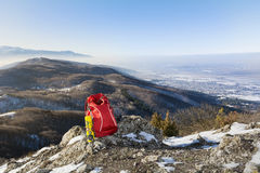 Tourist backpack in mountains landscape under blue sky Royalty Free Stock Image