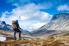 Tourist with a backpack in the mountains Stock Photography