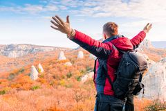 Tourist with a backpack with open arms enjoying the autumn lands stock photos