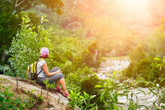 Tourist with backpack sit and relaxing enjoying sunset Royalty Free Stock Images