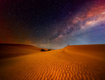 Tourist with backpack standing on top and enjoying night sky Royalty Free Stock Photo
